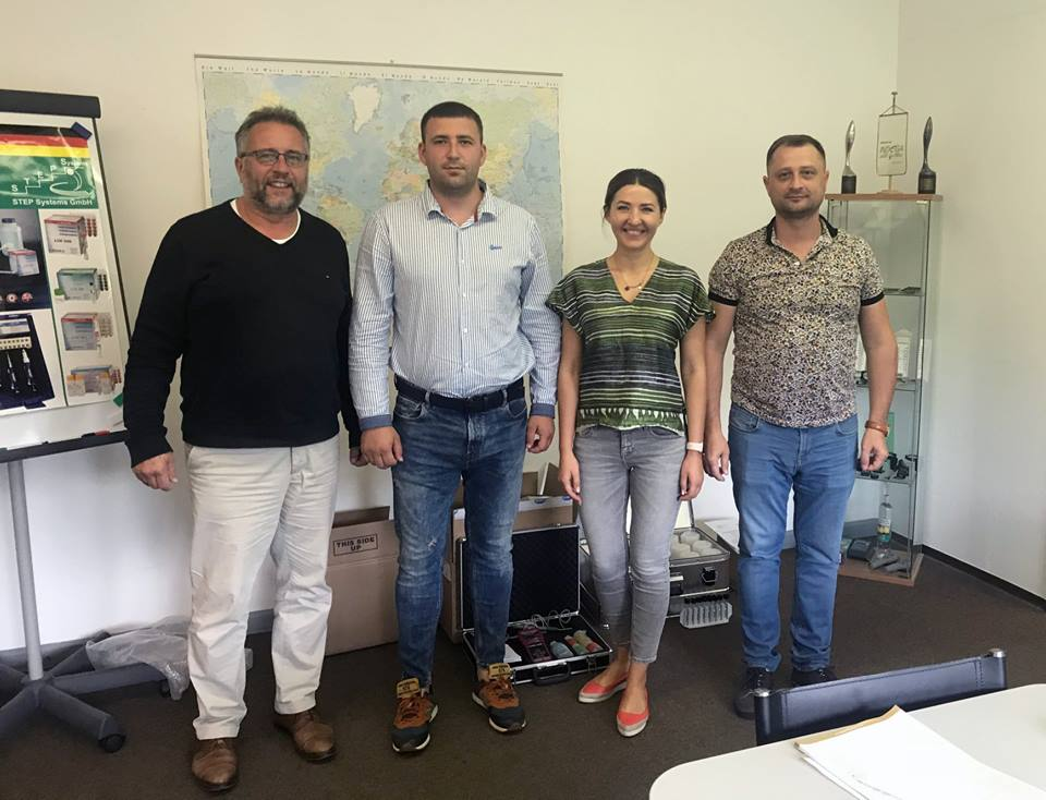 Harald Braungardt and Yana Murashova from STEP Systems GmbH with Serhii Shylo and Pavlo Basjuk from the company SHYBAS